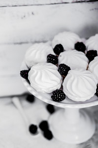Meringue Cookies Witj Blackberries On Rustic Background