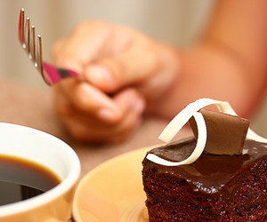 Eating Some Chocolate Cake With A Cup Of Coffee