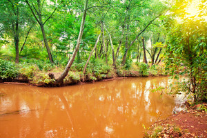Eco unfriendly. Red river poluted by steel plant. Zaporozhye city