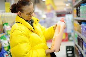 Elderly woman buying shampoo