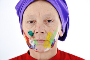 Elderly woman grandmother with painted face over white background