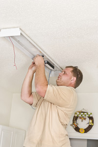 Electrician Installing Flourescent Lighting Ballast