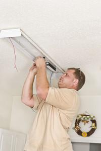 Electrician Installing Flourescent Lighting Ballast