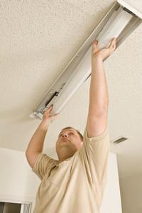 Electrician Installing Flourescent Lighting