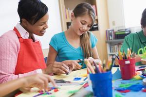 Elementary pupil in art class with teacher