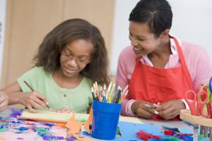 Elementary school art class with teacher
