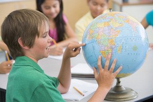 Elementary school geography class with globe