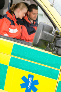 Emergency ambulance car paramedics sitting  medical work female doctor
