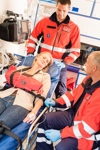 Emergency patient stabilization broken arm in ambulance car transport hospital