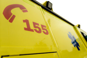 Emergency phone number and paramedic sign on ambulance car