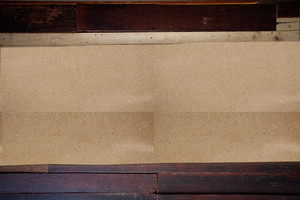 Empty brown Crumpled paper on wood background horizontal