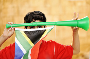 encourager with vuvuzela and flag