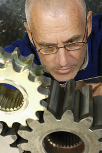engineer examining geometry of a cogwheel