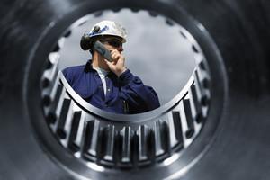 engineer seen through a large cogwheels axle
