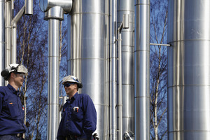 engineer with tall gas pipes, pipelines