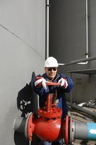 engineer, worker turning a pipelines pump
