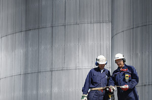 engineers in hardhats against steel wall