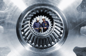 engineers, workers inside gears axles