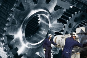 engineers working with cogs machinery