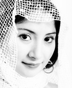 Ethnic Muslim Woman With A  Netted Headscarf