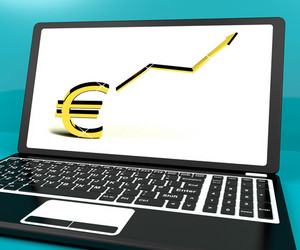 Euro Sign And Up Arrow On Computer For Earnings Or Profit