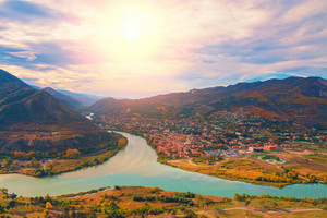 Evening panoramic view of Mtskheta city and Kura river from Jvari monastery at sunset. Georgia. Europe