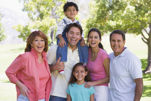 Extended family standing outdoors smiling