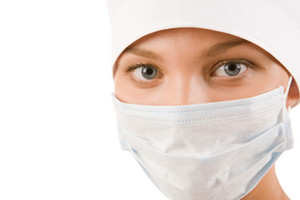 Face of nurse in sterile mask looking at camera