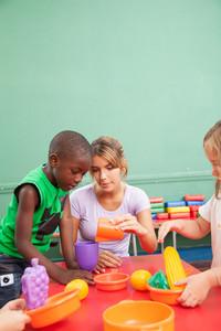 Famale teacher playing in kindergarten