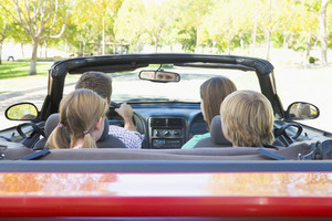 Family in convertible car