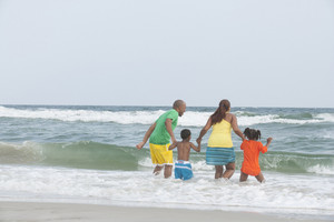 Family in surf at the beach
