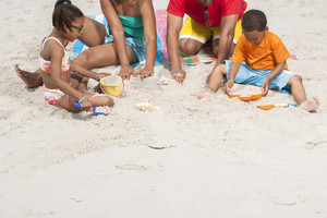 Family making sand castles at the beach