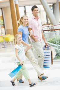 Family shopping in mall carrying mall