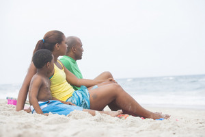 Family viewing ocean at the beach