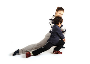 Family - young woman and kid - doing sport, fitness exercises indoors