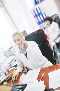 Pharmacy worker talking by phone