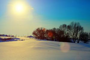 Farmstead in snowy winter at evening light