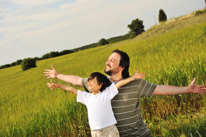 Father and son in wheat at summer