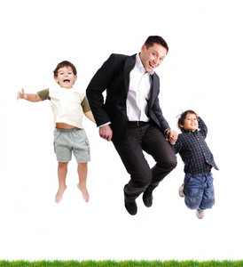 Father and sons  jumping over green grass, isolated