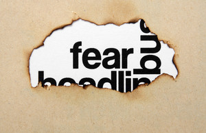 Fear Text On Paper Hole