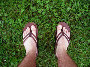 feet with sandals walking through some fresh