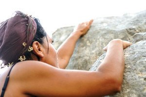 Female climbing rock on the mountain
