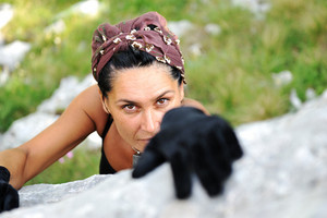 Female climbing the rock on mountain