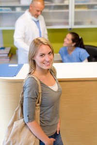 Female patient coming to dental surgery check-up appointment reception
