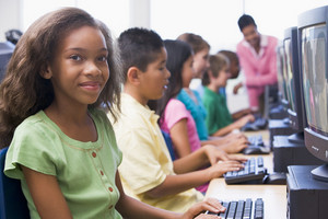 Female pupil in school computer class