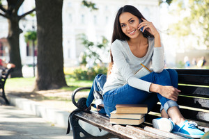Female student talking on the phone outdoors