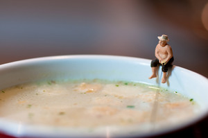 Figurine Fisherman Fishing In A Soup Mug.