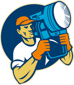 Film Lighting Crew Holding A Spotlight