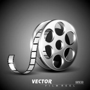 Film Reel On Grey Stage Background.