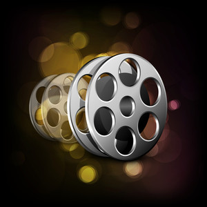 Film reel on shiny background